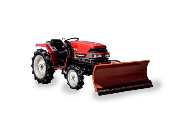 Snow plow on Yanmar compact tractor