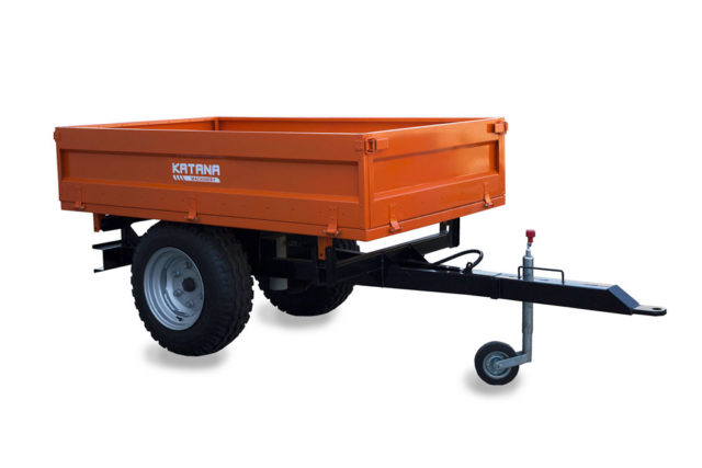 Mid size tipping trailer for compact tractor